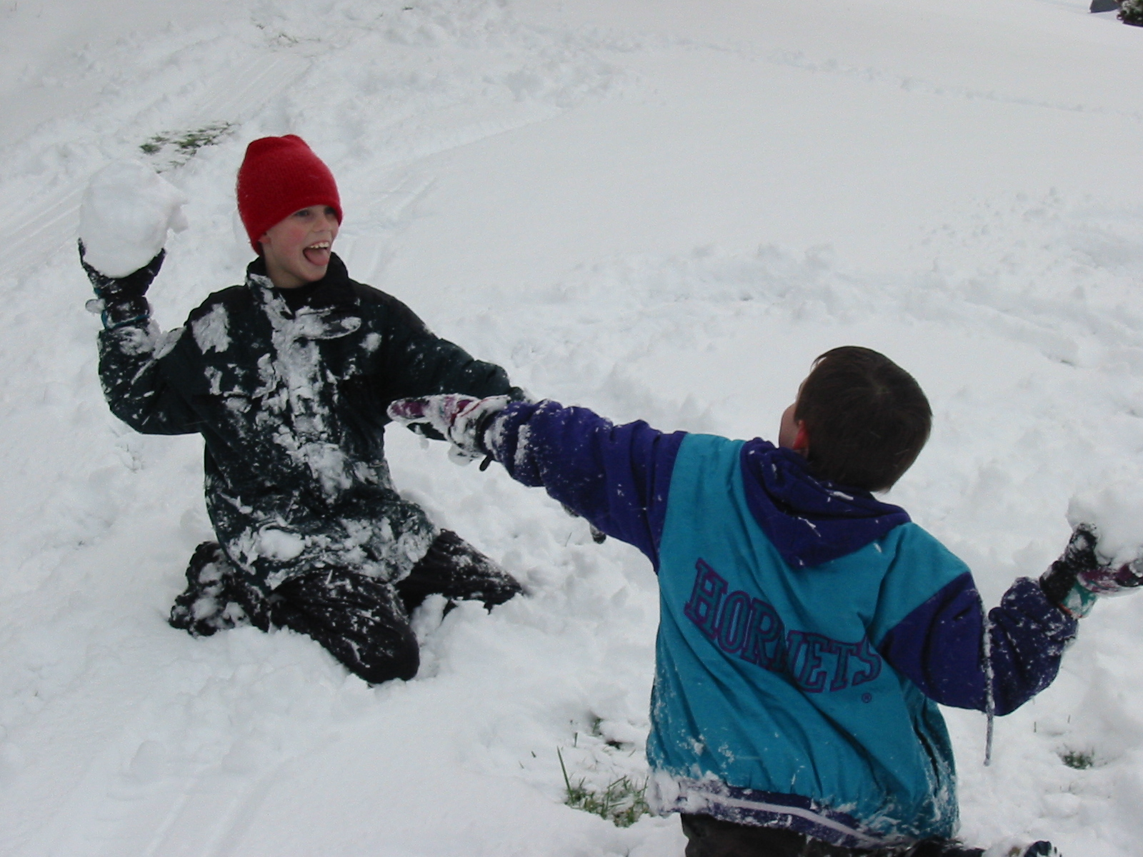 Stephen and his friend, Taylor, throwing snowballs.